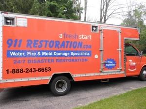 911 Restoration Ventura Truck at Job Location